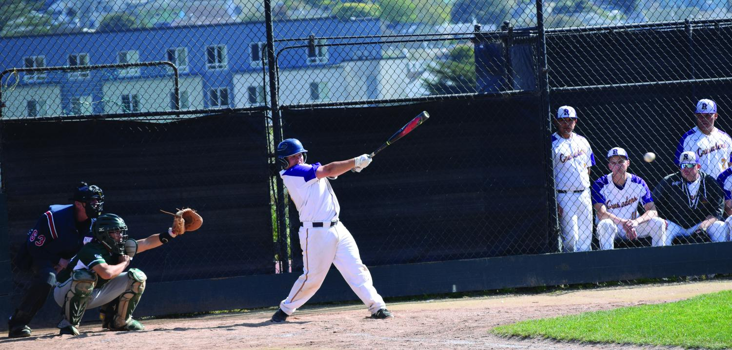 Matt Yeung '19 swings during a game for the Crusaders
