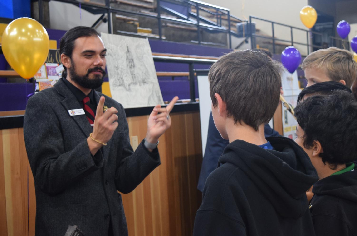 Social Science Department Chair Chris Fern talks to prospective Riordan students about history at Open House this past October.