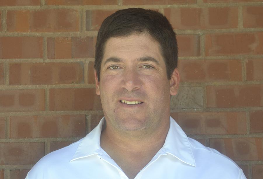 New Head Varsity Football Coach Mark Modeste