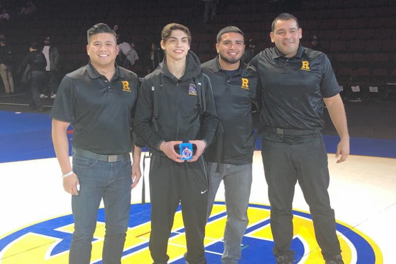 Michael+Bigler+%E2%80%9920+celebrates+his+win+with+coaches+Tony+Tran+%E2%80%9902%2C+Zack+Contreras+%E2%80%9913%2C+and+Jose+Herrera.