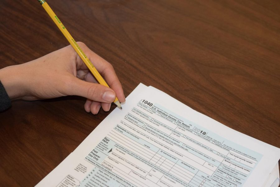 One of the goals of the proposed financial course for high school students is to teach them how to fill out tax forms.