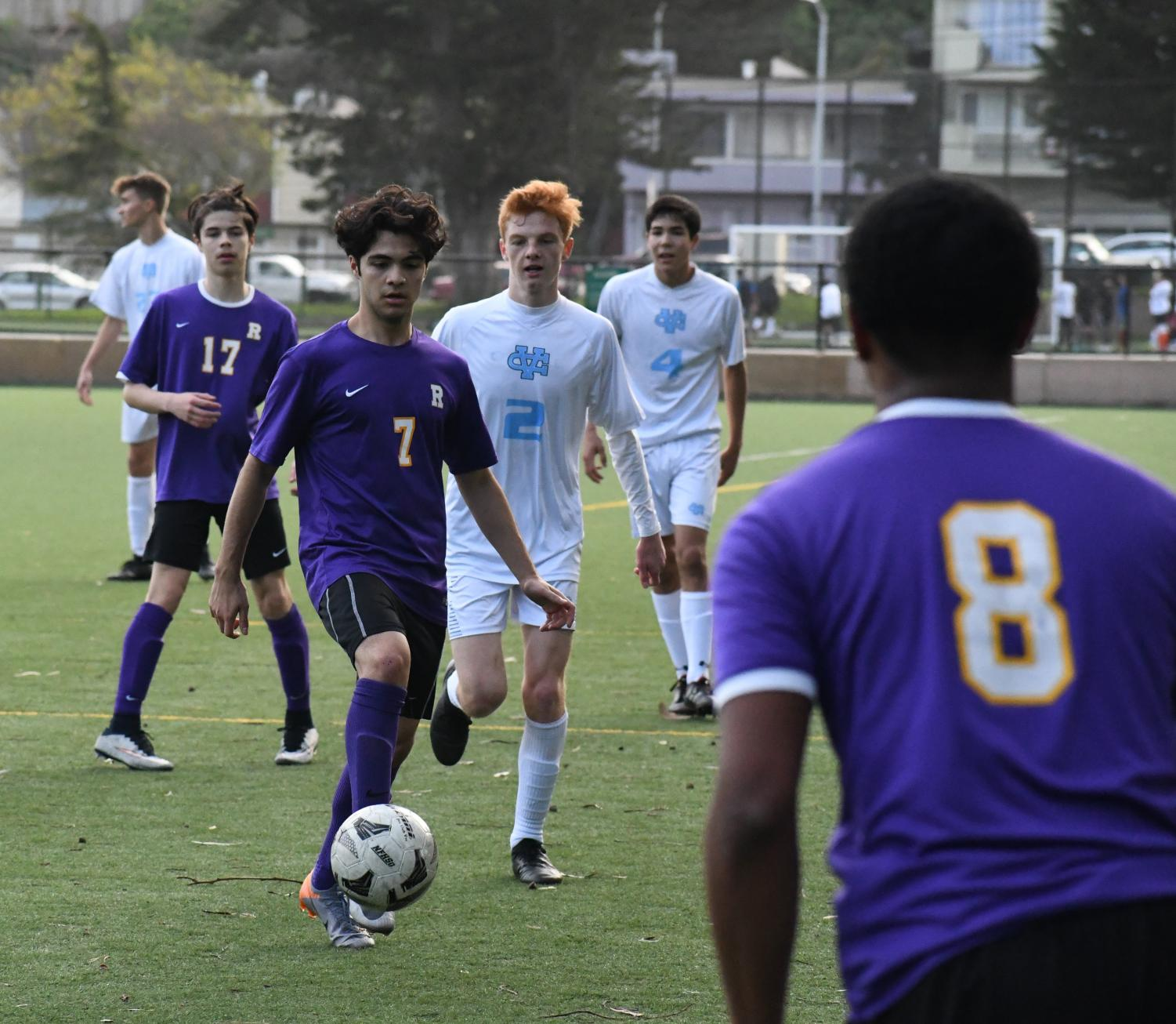 Max Gomez '19 dribbles the ball downfield in a game against Valley Christian