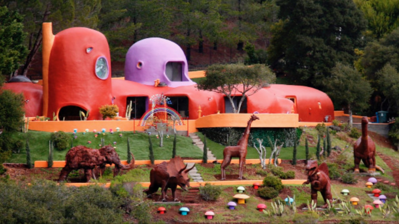 The back of the Flintstone House can be seen from Interstate 280.