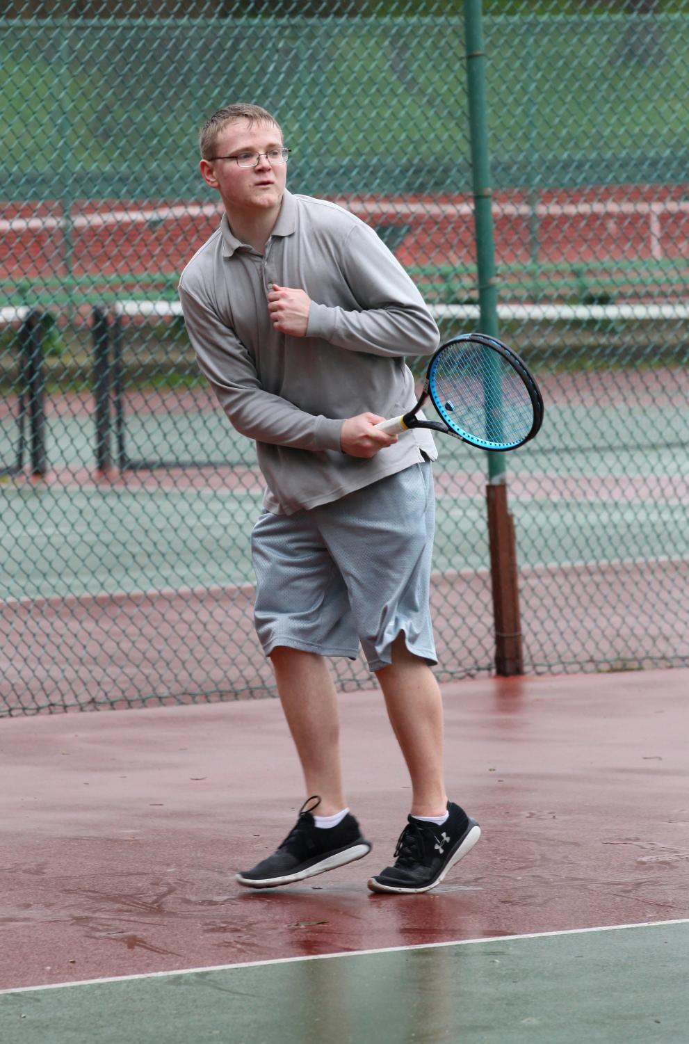 Caelan Bevan-Abel '19 warms up before a tennis match at Balboa.