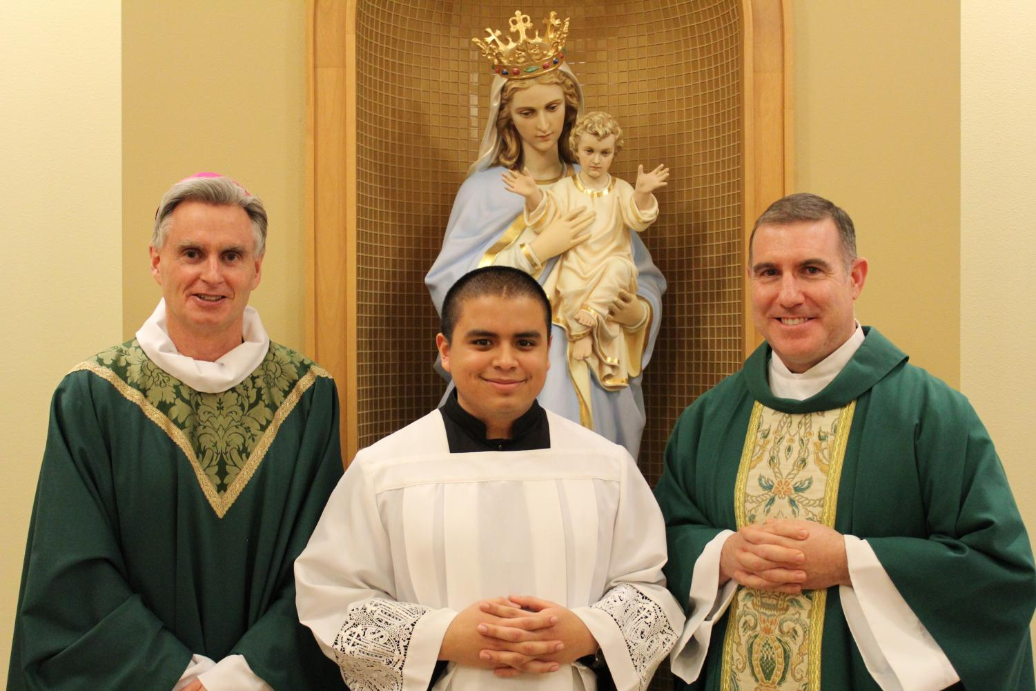 Jimmy Velasco '17 (center) with Bishop Thomas Daly of Spokane (left), and Fr. Patrick Summerhays, Director of Vocations for the Archdiocese.