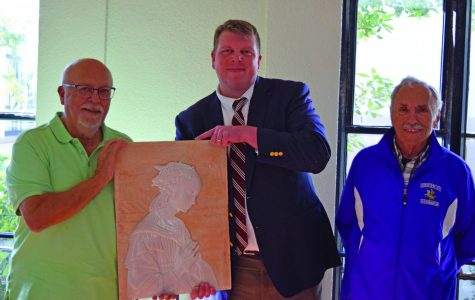 Chuck Murillo '55 donated a piece of artwork to Riordan, which President Andrew Currier graciously accepted. Paul Osborne '55 accompanied his classmate to their alma mater for the event.
