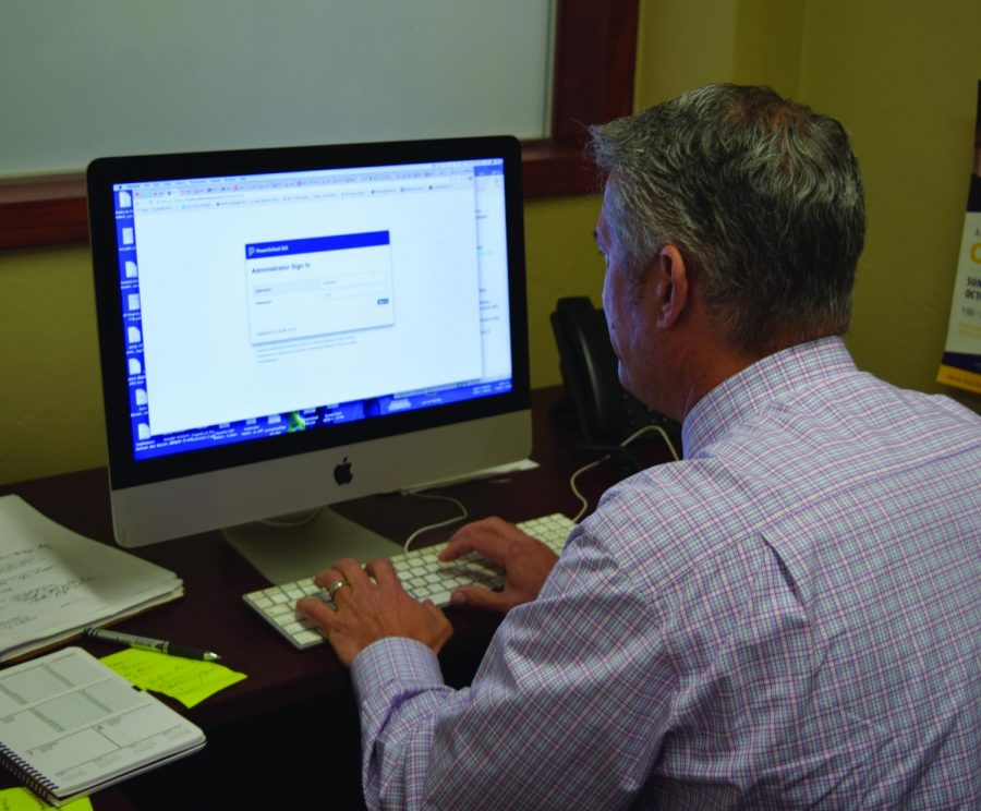 Dean of Academics Michael O'Brien logs on to PowerSchool.