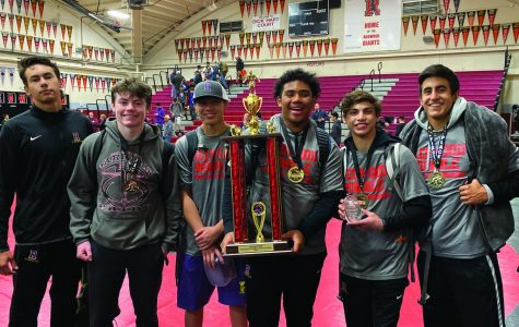 Wrestling team pins down season's first trophy