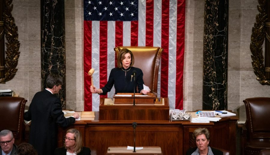 Speaker of the House Nancy Pelosi bangs the gavel, announcing impeachment proceedings had begun.