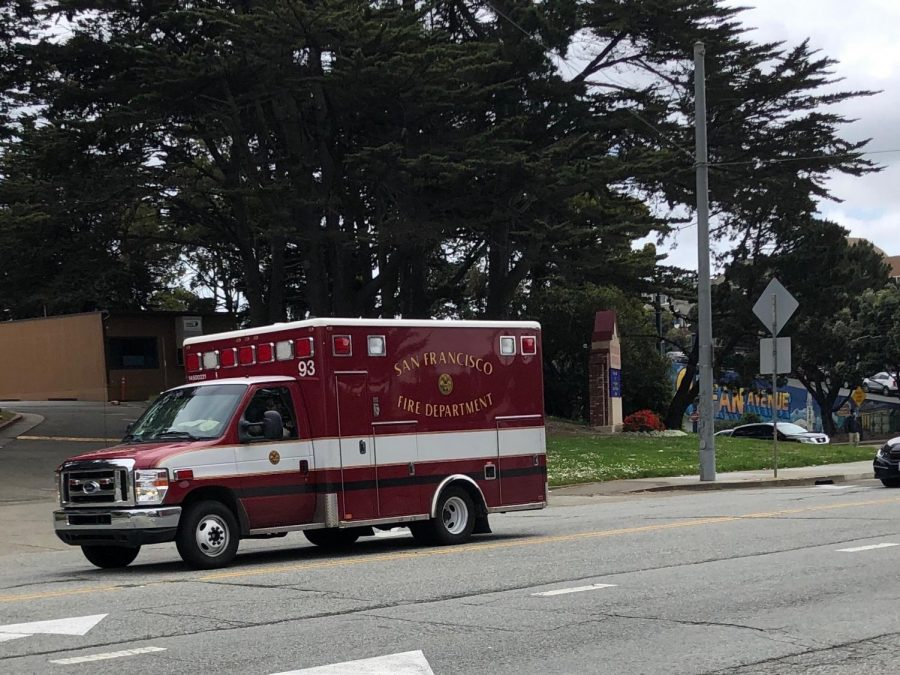 An ambulance driving on Ocean Ave in San Francisco.