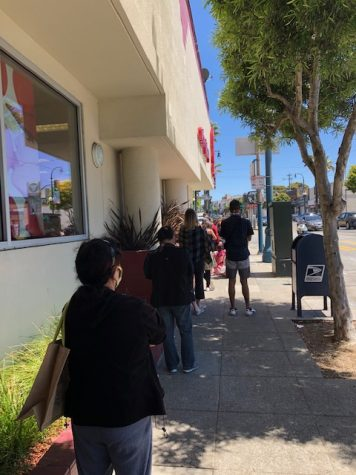 A lengthy line forms outside the Target on Ocean Ave in San Francisco.