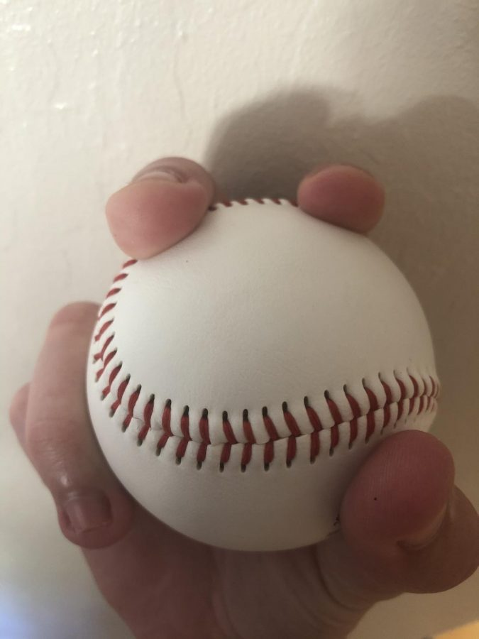 A four-seam fastball grip is displayed, a pitch the cheating teams often knew was coming.