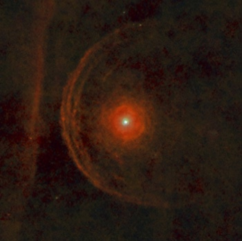 This infrared photo shows the star Betelgeuse, in the shoulder of Orion, about to collide with a nearby gas cloud.