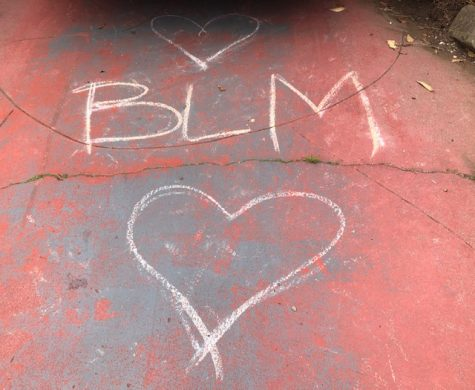 A chalk Black Lives Matter drawing in a driveway in the Ingleside neighborhood near Riordan.