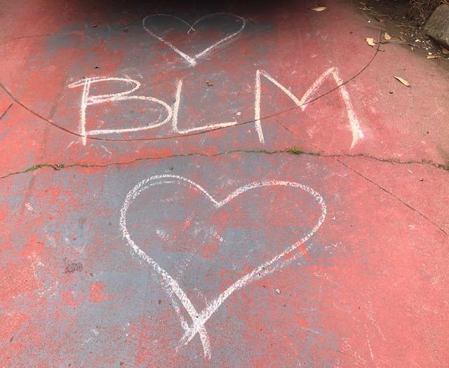 A chalk Black Lives Matter drawing in a driveway in the Ingleside neighborhood near Riordan.