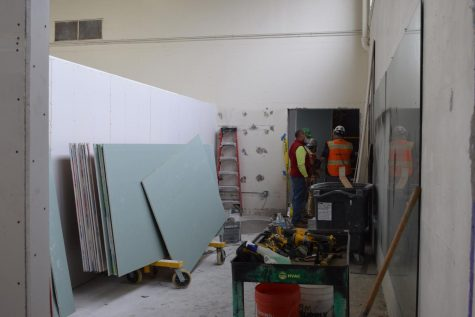 Construction workers have been diligently working toward the completion of the revitalized athletic facility, with locker rooms for boys and girls, and a shared weight room.