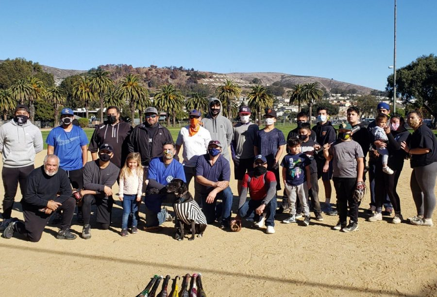 In a change to their traditional Thanksgiving family football game, members of two South San Francisco families switched it up to softball to avoid contact during the COVID pandemic.