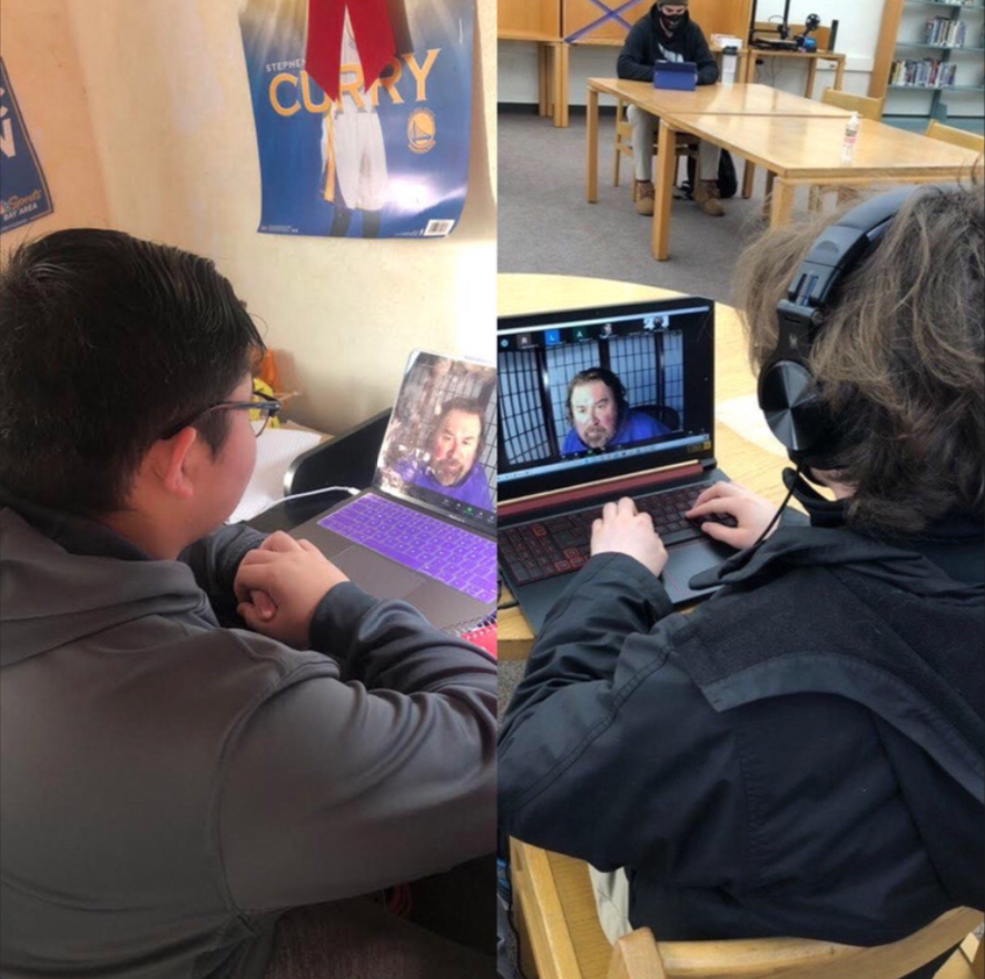 Jordan Maralit '21 attends Kenn Swan's class via distance learning while Alex Key '21 participates in the class on campus.