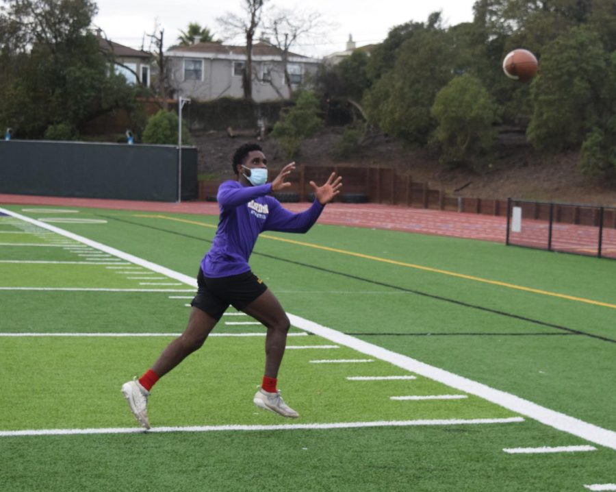 Christopher Murray '22 catches a pass at the sidelines during workouts.