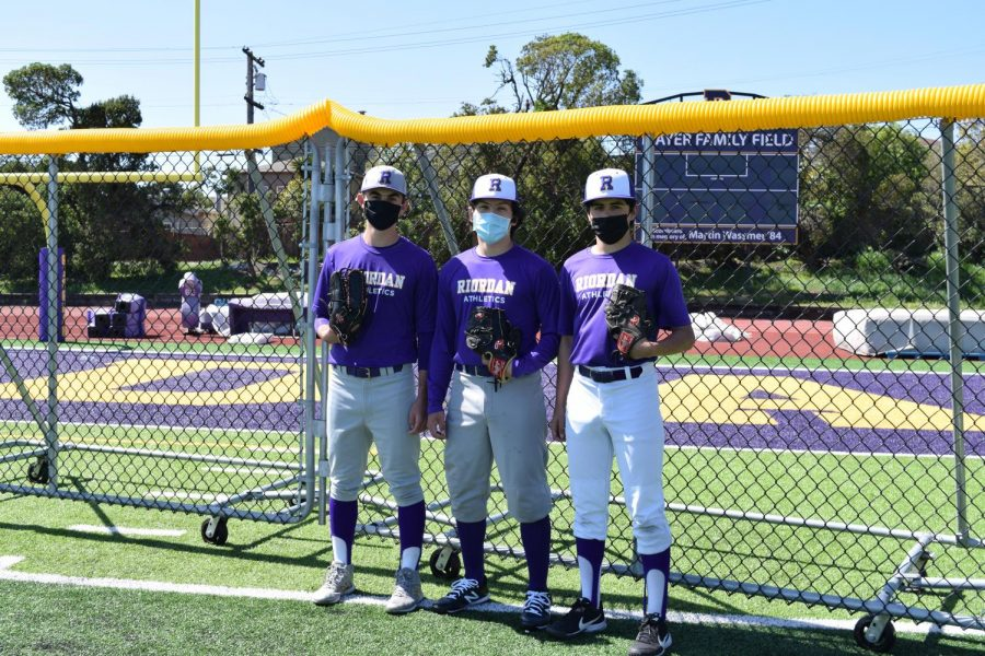 Outfielders Andrew Parenti '22, Ian De Vaynes '21, and Antonio Roca '21 prepare to defend the new home run fence on Mayer Family Field.