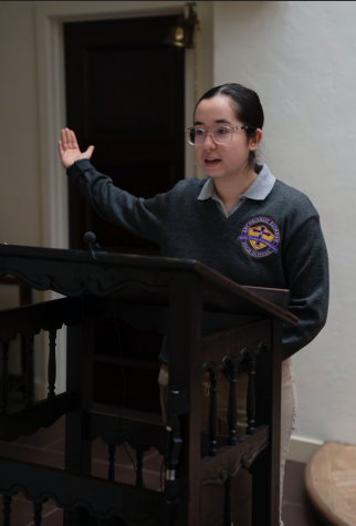 Maya Torres '22, member of the ARHS CORE Team, reads the responsorial psalm at one of this year's prayer services.