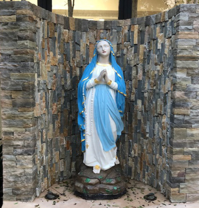 The Our Lady of Lourdes statue was cleaned, repainted, and encircled in a stone grotto to emulate the site where the Virgin Mary appeared.