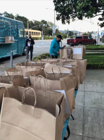 Dozens of food orders wait to be picked up in front of the school on Jan. 29, the first of three days the catering truck accepted pre-orders in a fundraiser for Archbishop Riordan that collected nearly $1,000.