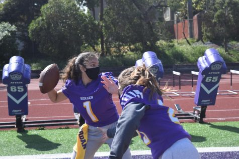Elci Cortes '22 and Delaney Mulqueen '22 demonstrate what a girls flag football team might look like on Mayer Family Field in the near distant future