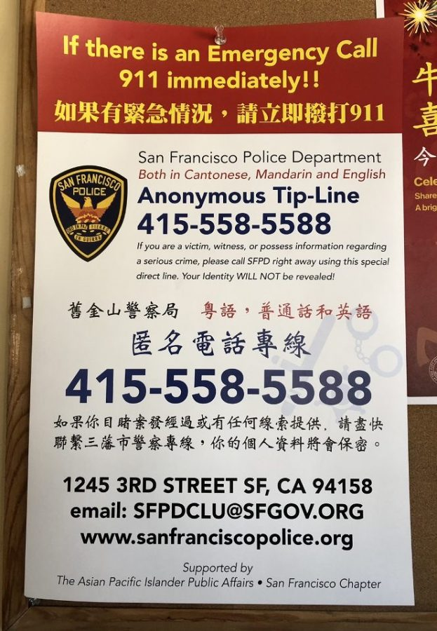The SFPD and Asian Pacific Islander Public Affairs created posters such as this one in a business window on Ocean Avenue to advise people how to report hate crimes.