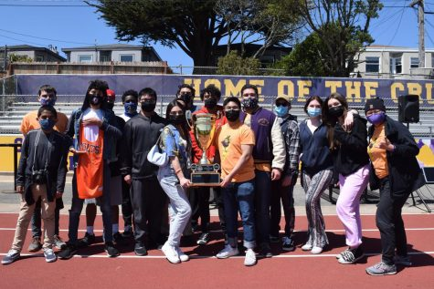 Members of the House of Bolts celebrate their repeat win of the Chaminade Cup at the Crusader Games BBQ.