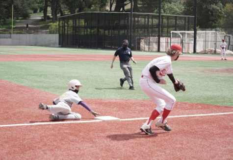 Brady Nemes 24 slides into third base just under a defenders throw.