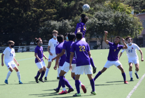 Oisin McClorey '22 heads the ball as his Crusader teammates try to gain possesion.
