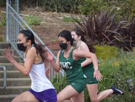Hannah Bitonio '23 sprints past two SHC runners at a meet last month on Mayer Family Field's track.