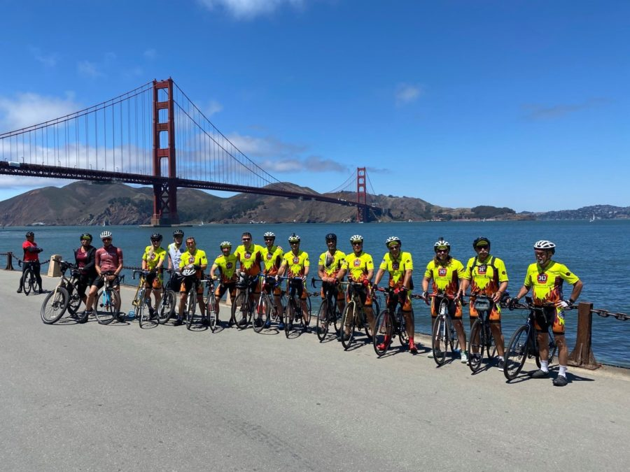 Frank Walsh 67 and fellow retired and active firefighters stand in front of the Golden Gate Bridge before leaving on their Bay to Brooklyn bike ride to commemorate the more than 300 firefighters who died on 9/11.