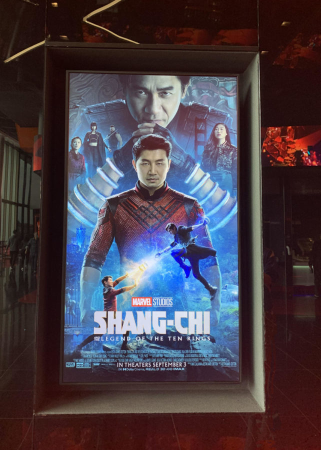 The Shang-Chi movie poster at the Regal Stonestown Galleria welcomes guests to the theater.